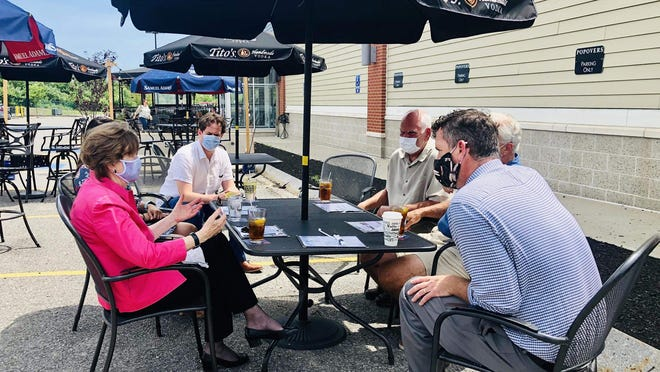 Sen. Jeanne Shaheen, D-NH, meets with Popovers owners John Tinios and Steve James at their Epping restaurant to learn more about their experience with the Paycheck Protection Program.