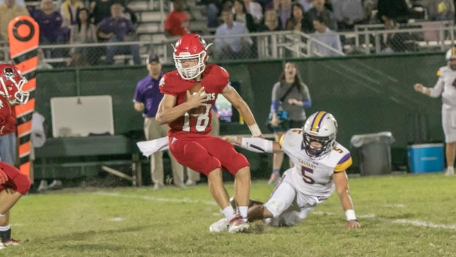 Spencer Robicheaux of Savannah Christian eludes a rusher in a regular-season win over Calvary Day last year.