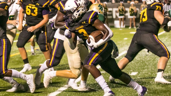 Calvary Day senior running back Greg Daniel (3) runs straight up the middle for a nice gain against Bulloch Academy earlier this season at Calvary Day School.