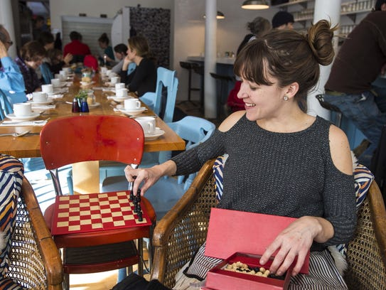 Owner Mary Alice Proffitt sets up a chess board for
