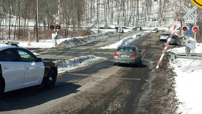 An arm for safety gates at the Roaring Brook Road rail crossing in Chappaqua, N.Y., was broken by a motorist who became stuck at the crossing Saturday, March 7, 2015 .