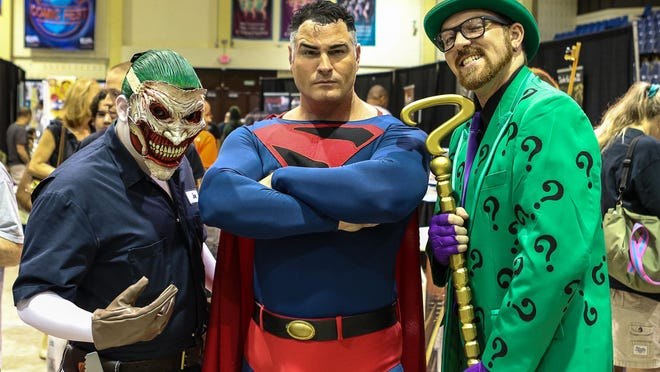 From left, Andrew Arkham of Bayside, NY, as the Joker, Michael Byrnes of Mt. Holly, as Superman, and Jack Debenedetto of Clifton, as the Riddler, pose in costume at the Garden State Comic Fest at Mennen Sports Arena in Morristown on Saturday.
