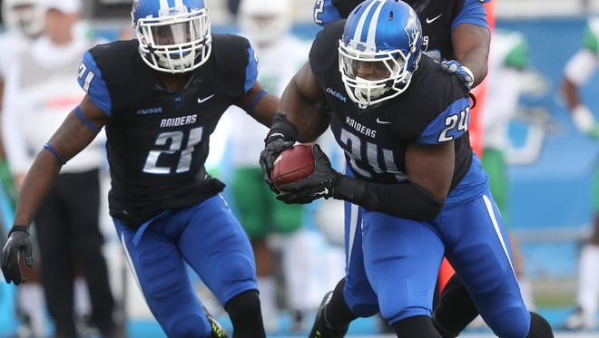 MTSU's Jamarcus Howard (21), T.T. Barber (12) and Cavellis Luckett (24) will all suit up in blue and white for the final time at the Popeyes Bahamas Bowl on Dec. 24.