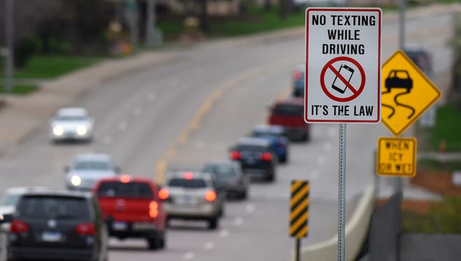 A road sign near Spencer Park along Cliff Avenue reminds drivers that texting while driving is against the law.