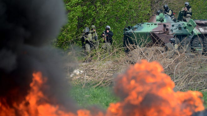 Ukrainian special forces take positions in the eastern Ukrainian city of Slovyansk on April 24.