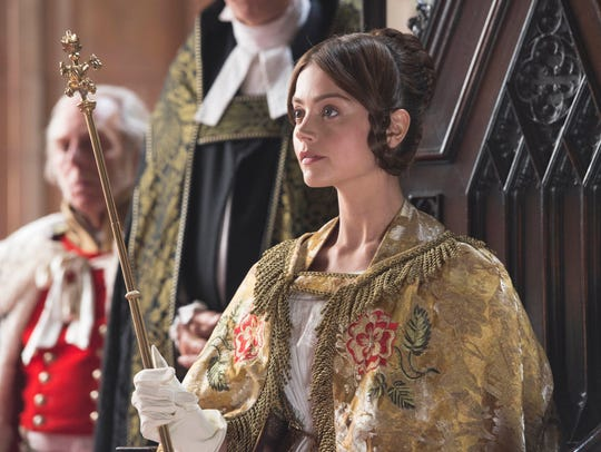 A young Queen Victoria (Jenna Coleman) takes her place