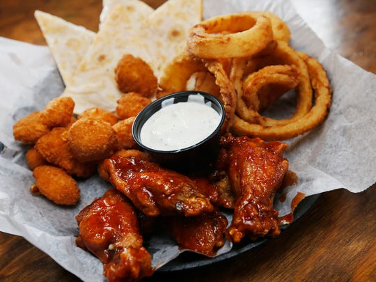 The Sec Taylor sampler from Johnny's Hall of Fame comes with cheddar nuggets, onion rings, cheese quesadilla wedges and Johnny's wings, served with a choice of appetizer sauces.