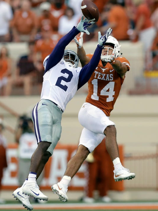 Kansas State defensive back D.J. Reed (2) intercepts a pass intended for Texas wide receiver Lorenzo Joe (14) during the first half of an NCAA college football game, Saturday, Oct. 7, 2017, in Austin, Texas. (AP Photo/Eric Gay)
