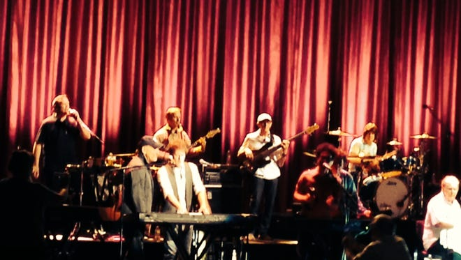 Bruce Springsteen (black cap) and Brian Wilson (white shirt) at the PNC Bank Arts Center in Holmdel on Wednesday, July 1.