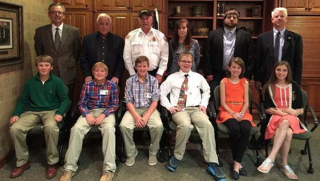 Each year the Mountain Home Kiwanis Club sponsors Student Government Day. Students elect their officials who spend a day with their counterpart. Here are the city officials, front row, from left, Trent Jordan (City Attorney), Dodge Harris (Mayor), Gaige Chaney (Fire Chief), Xander Phillips (City Treasurer), Rayne Tilley (City Clerk) and Sarrah Vacco (Police Chief). Back row, Mountain Home City Attorney Roger Morgan, Mountain Home Mayor Joe Dillard, Mountain Home Fire Chief Ken Williams, Mountain Home Treasurer Debbie Cotter, Mountain Home City Clerk Brian Plumlee and Mountain Home Police Chief Carry Manual.