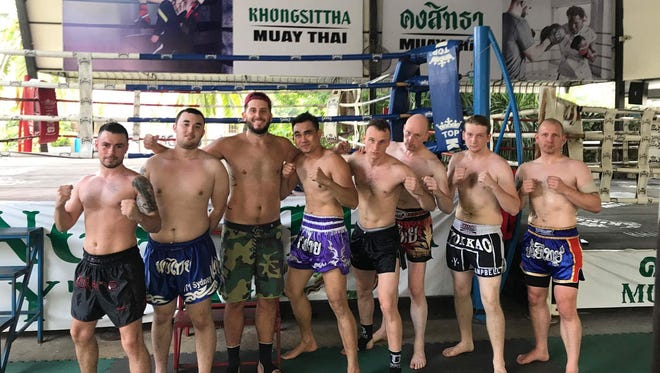 Lyndhurst's Dylan Campbell, second from the right, spend a month in Thailand this summer studying muay Thai fighting.