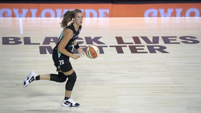 New York Liberty guard Sabrina Ionescu pushes the ball up the court against the Seattle Storm during Saturday's game.