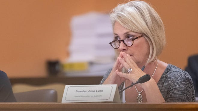 Sen. Julia Lynn listens to testimony during a hearing in the Statehouse last year.