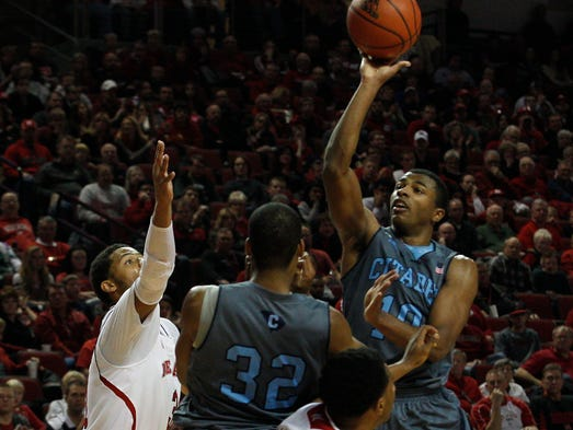 Citadel guard Marshall Harris III puts up a shot over forward Brian White and Nebraska guards Shavon Shields and guard Benny Parker at Pinnacle Bank Arena.
