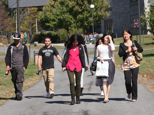 Students walk to class on the campus of Westchester