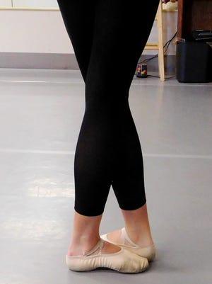 A Pas de Vie dancer in fifth position