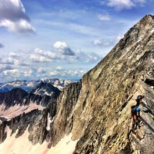 Kyle Lusk and Morris Hogan traverse Capitol Peak's infamous 'Knife Edge' this summer. They along, with friend, Austin Johnson, climbed 55 fourteeners this summer, biking to the trailhead of each one.