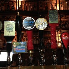At The Three Johns pub in London, craft beers from around the world, including two from Odell Brewing Co., are on tap.