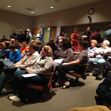 About 100 people attended Monday's school board meeting. More than half attended specifically for the discussion on former lacrosse coach Jeremy Napier.