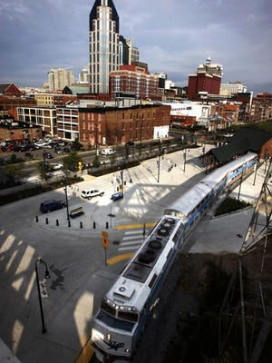The Music City Star in 2006 pulls into the Riverfront station in downtown Nashville on the opening day which drew a large crowd to the new commuter rail service running from Lebanon to downtown Nashville.