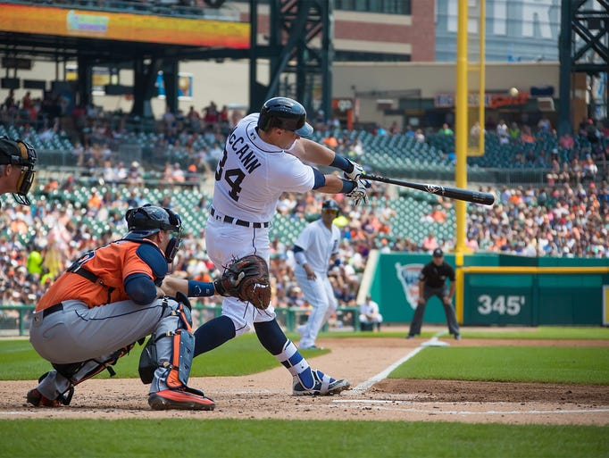 The Detroit Tigers' James McCann hits a grand slam