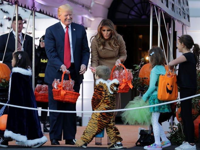 El presidente de EU Donald Trump y su esposa, la Primera
