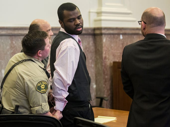 Lamar Wilson is put in handcuffs after being found