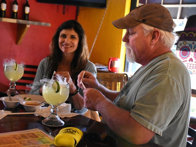 "Visitors Jim and Pam Bullinger sample ""zazaritas,"""