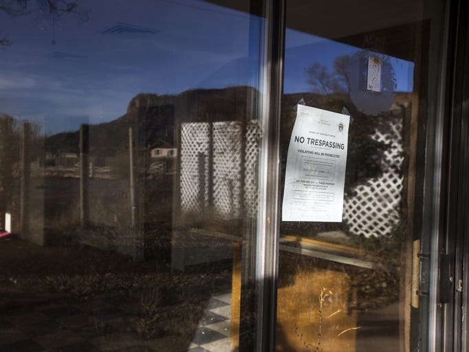 An eviction notice is seen at a house in Short Creek,