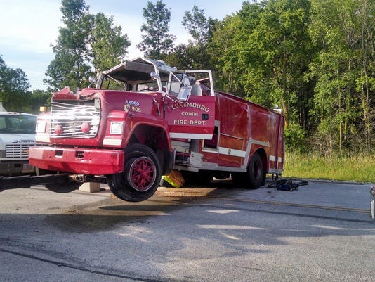Luxemburg firetruck rolls, driver injured