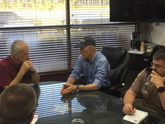 Florida Gov. Rick Scott meets with emergency officials