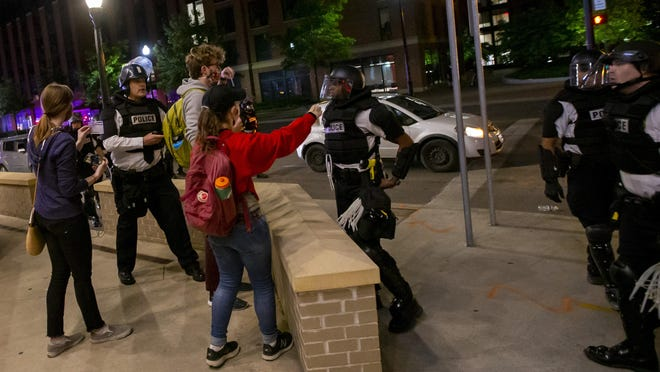 Columbus Police threaten to arrest journalists from The Lantern, Ohio State's student newspaper, for breaking curfew following a peaceful protest for George Floyd that ended near campus on Monday, June 1, 2020. The students were forced to leave after being sprayed with pepper spray.