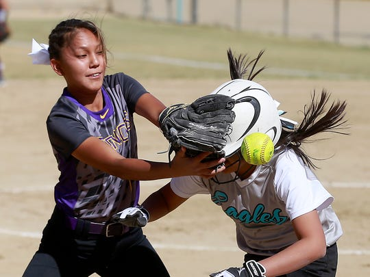 Kirtland Central's Dominique McGilbert attempts to tag out Navajo Prep's Kylie Cayedito at third base on Tuesday at Navajo Prep.
