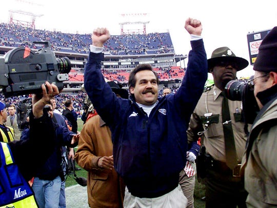 Tennessee Titans coach Jeff Fisher, center, celebrates with the fans after his Titans 22-16 victory over the Buffalo Bills in the AFC wildcard playoff game at Adelphia Coliseum Jan. 8, 2000.