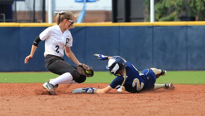 Mattawan's Genevieve Soltesz gets into second base ahead of a tag attempt by Plymouth's Gina Barber.