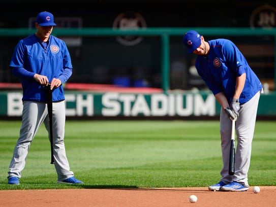 "Rizzo and Bryant doing some ""putting"" during an off"