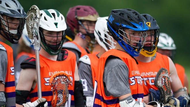 Eville Storm U19 players watch the field during the 2018 Thunderbolt Shootout on Sunday, June 10, 2018.