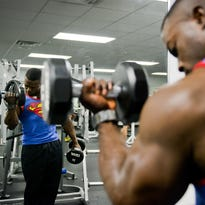 Senior Airman Terrence Ruffin lifts 25-pound dumbbells at the fitness center on Eglin Air Force Base, Fla.