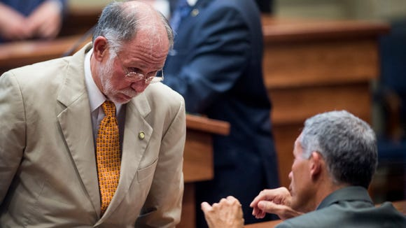 Sen. Jim McClendon, left, talks with Sen. Del March during the Special Session of the Alabama Legislature at the Alabama Statehouse in Montgomery, Ala. on August 18, 2016. Alabama Governor Robert Bentley called the special session to deal with a proposed lottery.