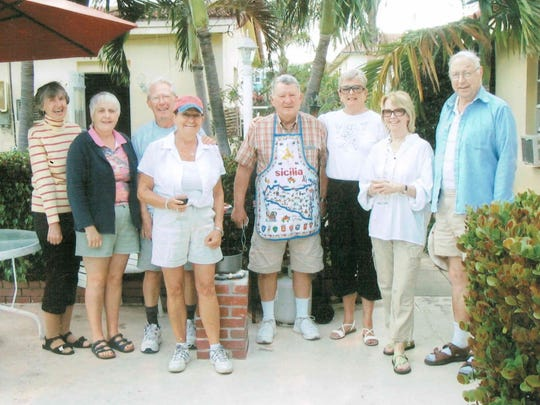 Robert Armitage (far right, in blue) visits friends in Florida.