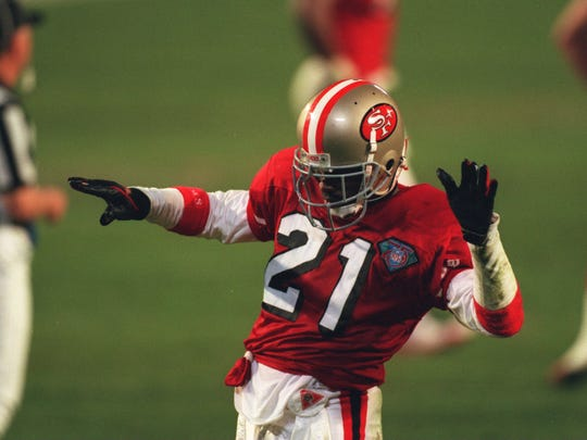 Deion Sanders celebrates a fourth-quarter play as the San Francisco 49ers defeat the San Diego Chargers 49-26 in Super Bowl XXIX at Joe Robbie Stadium in Miami.