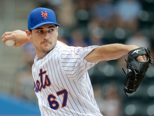 Mets pitcher Seth Lugo throws during the first inning
