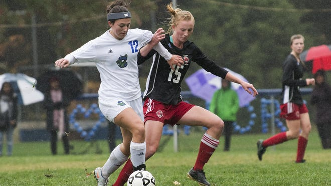 Colchester's Tabitha Myers (12) and CVU's Sierra Morton (15) battle for the ball during the girls soccer game at Colchester High School on Saturday morning.