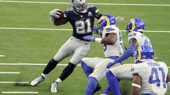 Dallas Cowboys' Ezekiel Elliott runs around a group of Los Angeles Rams defenders on his way to a touchdown after a catch during the Cowboys' 20-17 loss Monday in Inglewood, Calif.