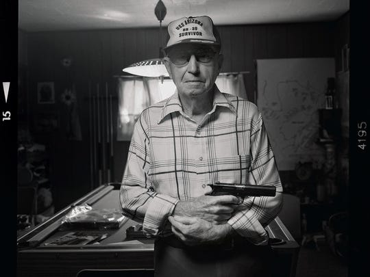 Ken Potts was ashore loading fruits and vegetables for the crew when the Japanese attacked Pearl Harbor. He returned to the ship climbed aboard to help evacuate wounded sailors. When he reached Ford Island he found the armory locked but found a pistol outside and kept it through the night. Since then he is never without a gun nearby.