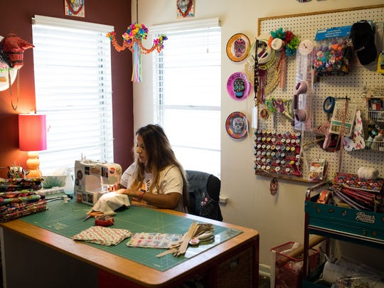 Elena Flores founder of Sew Bonita, uses a sewing machine in her home studio to make a bag on Saturday, Aug. 5, 2017.