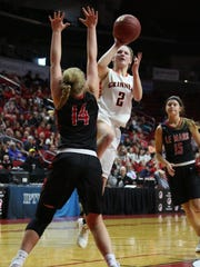Macy Harris, 2, Grinnell, goes for two points during