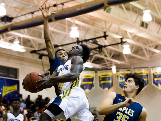 Lehigh guard Jar'Tavius Martin goes up for a shot during the Region 7A-3 semifinal at Lehigh Senior High School on Tuesday.