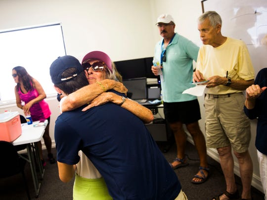 Sailor Robinson hugs his grandmother, Eileen Robinson, after completing his first solo flight on his 16th birthday on Wednesday, May 2, 2018, at Naples Municipal Airport.