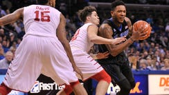 Memphis Tigers guard Markel Crawford (5) goes to the